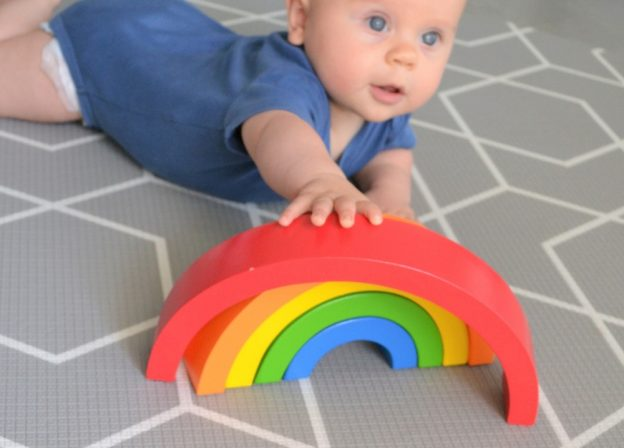 hand-me-down toys on grey geo play mat